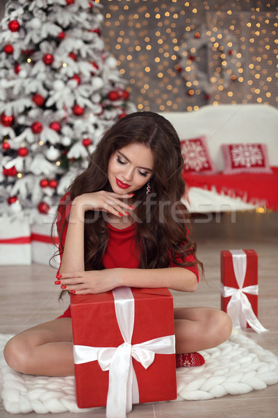 Christmas girl portrait. Beautiful santa woman present gift box. Stock photo © Victoria_Andreas
