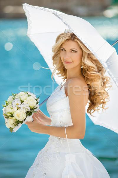 Gyönyörű mosolyog menyasszony lány esküvői ruha fehér Stock fotó © Victoria_Andreas