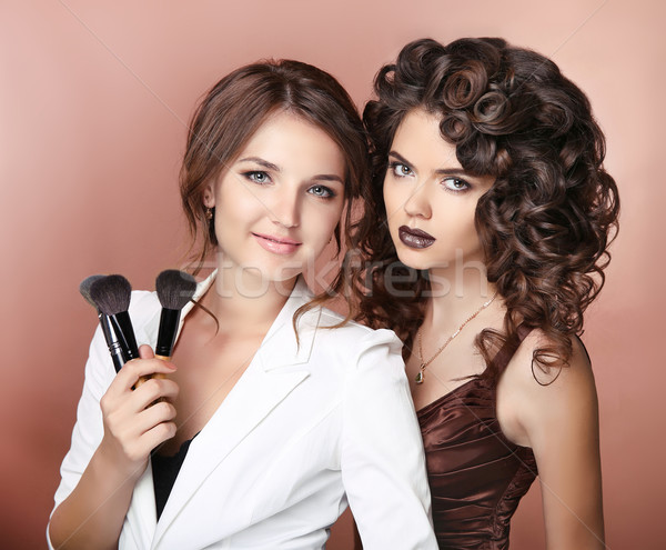 Artist. Healthy hair. Makeup. Two Beautiful brunette girls with  Stock photo © Victoria_Andreas