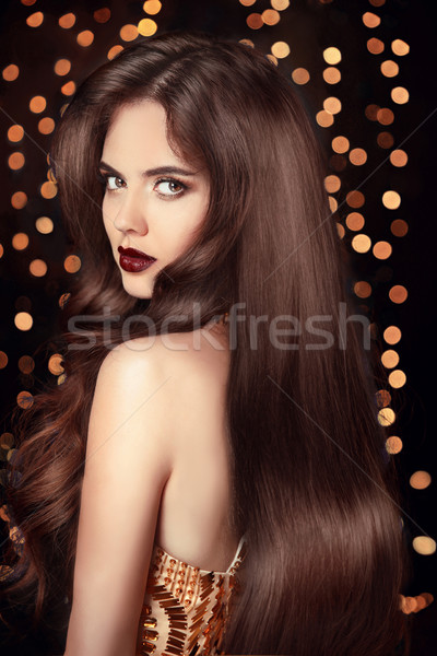 Beautiful Brunette girl with long shiny wavy hair. Elegant lady  Stock photo © Victoria_Andreas