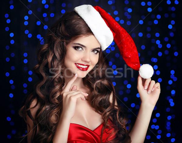 Gyönyörű boldog mosolyog lány mikulás kalap Stock fotó © Victoria_Andreas