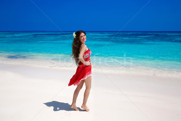 Beautiful smiling woman in red dress enjoying on exotic sea, tro Stock photo © Victoria_Andreas