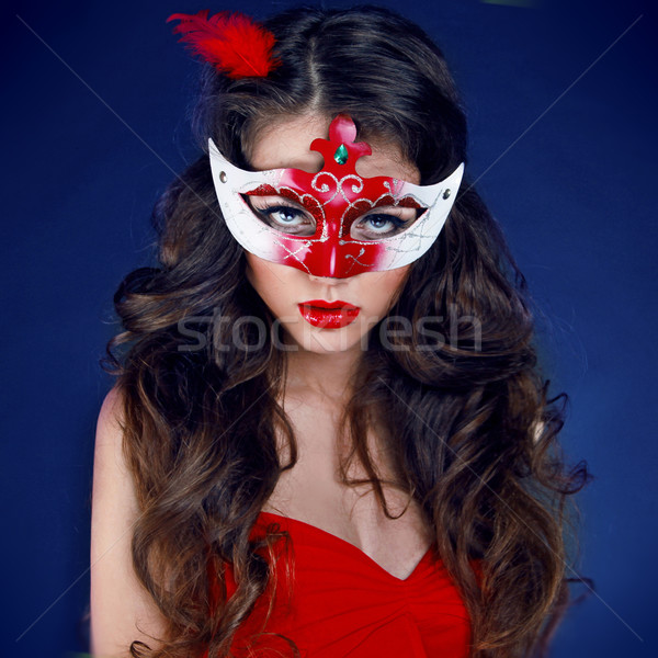 Masquerade. Beautiful Girl in Carnival mask with long curly hair Stock photo © Victoria_Andreas