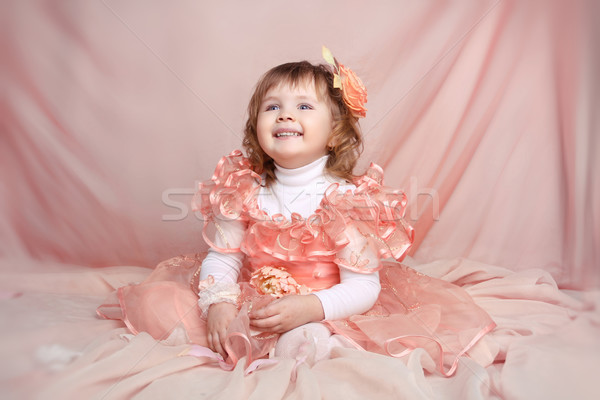 Happy smiling funny little girl looking up over drapery Stock photo © Victoria_Andreas