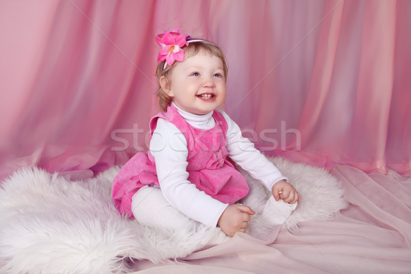 Happy smiling funny little girl smiling and resting on bed over  Stock photo © Victoria_Andreas