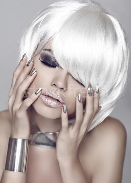 Fashion girl. Blond bob hairstyle. Eye makeup closeup. Beautiful Stock photo © Victoria_Andreas