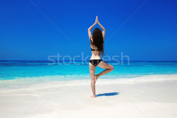 Woman meditating in tree yoga position on the exotic beach. Zen, Stock photo © Victoria_Andreas