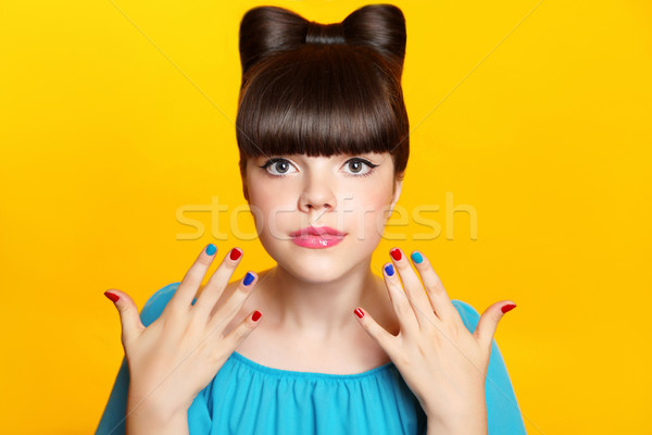 Makeup. Beautiful teen girl with bow hairstyle and multicolor ma Stock photo © Victoria_Andreas