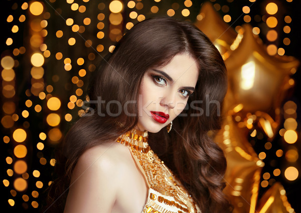 Elegant fashion brunette woman portrait in gold. Wavy hair style Stock photo © Victoria_Andreas
