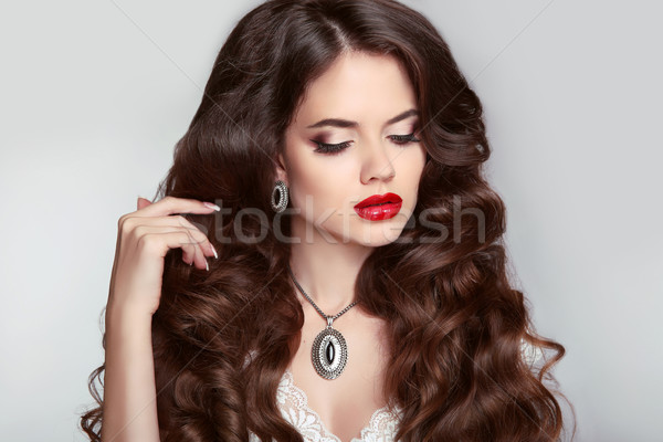 Beauty Makeup. Healthy hair. Beautiful girl with long wavy hairs Stock photo © Victoria_Andreas