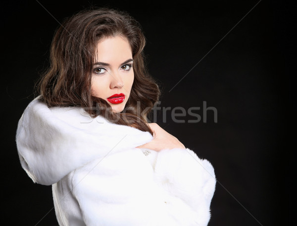 Fashion beauty woman in white fur coat isolated on black studio  Stock photo © Victoria_Andreas