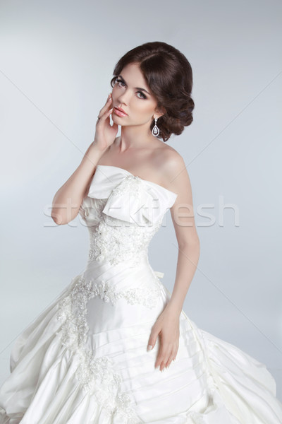 Fashion beauty young bride model posing in wedding dress with ha Stock photo © Victoria_Andreas