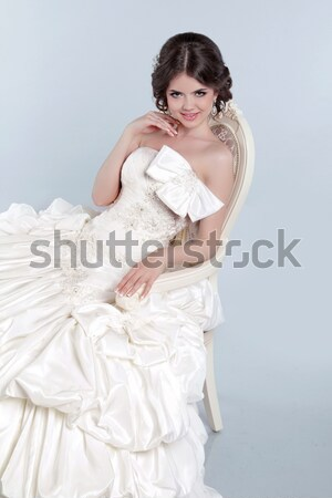 Beautiful bride model woman wearing in wedding dress with volumi Stock photo © Victoria_Andreas