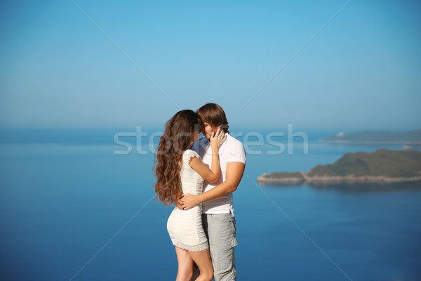 Passionate couple kissing over sea and blue sky background. Enjo Stock photo © Victoria_Andreas