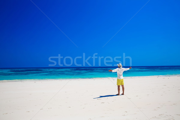 Nature. Seashore. Happy free Man Raising His Hands or Open arms  Stock photo © Victoria_Andreas