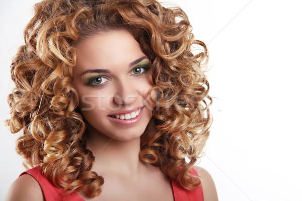 Saine cheveux bouclés séduisant femme souriante portrait blanche Photo stock © Victoria_Andreas