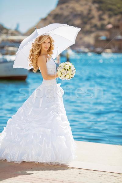 美しい 花嫁 ウェディングドレス 白 傘 屋外 ストックフォト © Victoria_Andreas