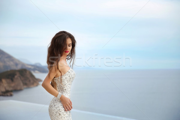 Beautiful bride girl in beaded wedding dress. Summer holiday fas Stock photo © Victoria_Andreas