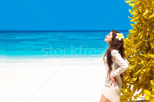 Beautiful free woman enjoying on exotic beach in summer by tropi Stock photo © Victoria_Andreas