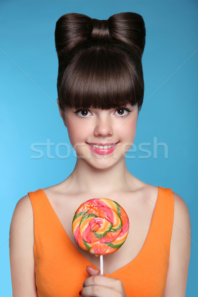 Beauty smiling teen girl Eating colourful lollipop. Attractive h Stock photo © Victoria_Andreas