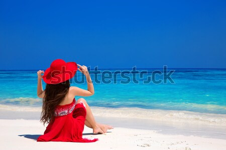 Healthy lifestyle. Beautiful carefree woman in hat enjoying exot Stock photo © Victoria_Andreas