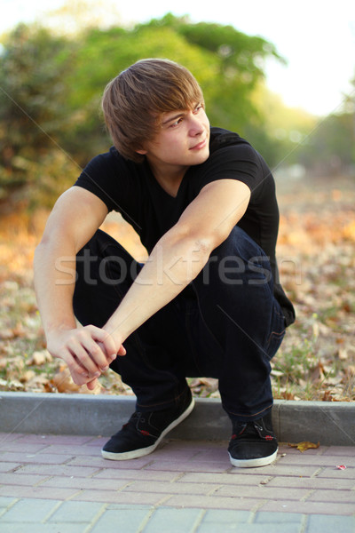 Young man look away, student outdoors, autumn park Stock photo © Victoria_Andreas