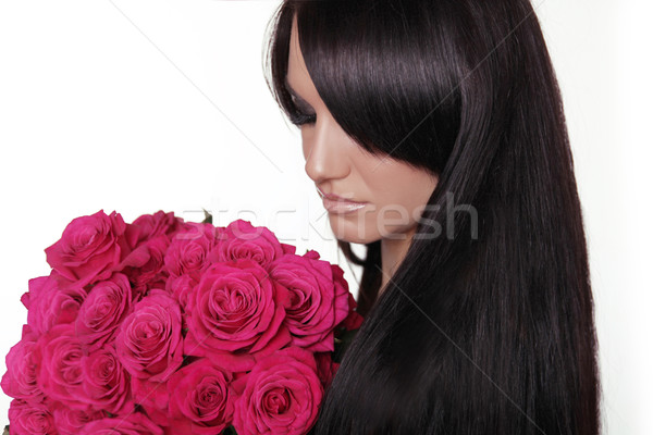 Healthy long hair. Brunette woman with fringe holding pink bouqu Stock photo © Victoria_Andreas