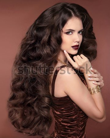 Fashion lady, sensual brunette woman with shiny curly silky hair Stock photo © Victoria_Andreas