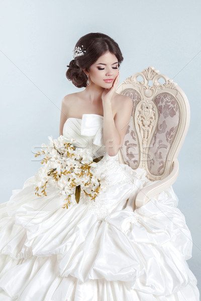 Beautiful bride model girl wearing in wedding dress with volumin Stock photo © Victoria_Andreas