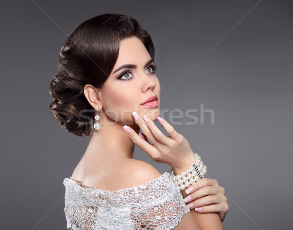 Retro woman portrait. Elegant lady with hairstyle, pearls jewelr Stock photo © Victoria_Andreas