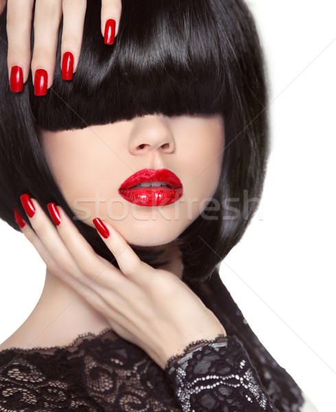 Manicured nails. Red lips. Black bob hairstyle. Brunette Girl wi Stock photo © Victoria_Andreas