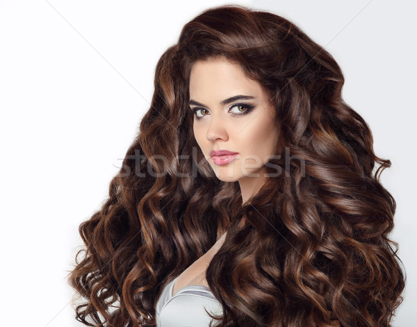 Long hair. Beautiful brunette woman portrait with curly shiny ha Stock photo © Victoria_Andreas