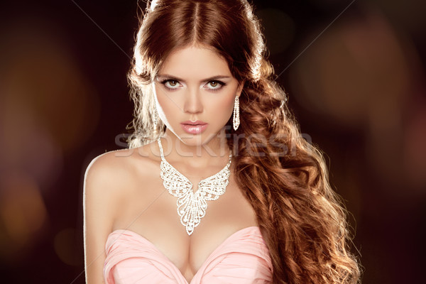 Fashion portrait of beautiful woman with long wavy brown hair st Stock photo © Victoria_Andreas