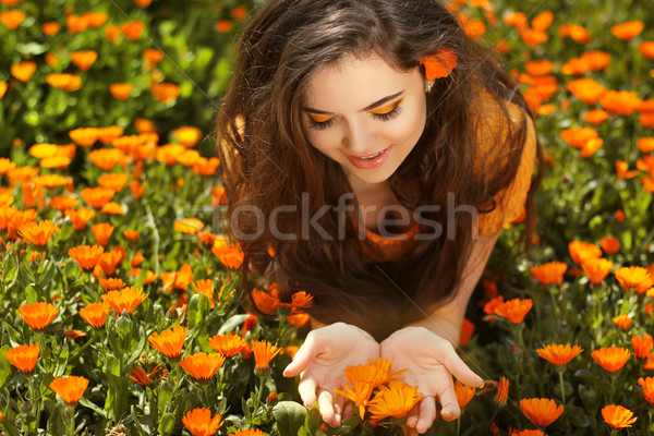 Beauty woman portrait with flowers. Free Happy Brunette Enjoying Stock photo © Victoria_Andreas