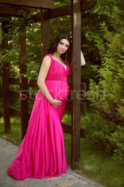 Pretty pregnant woman wearing in pink dress at green park Stock photo © Victoria_Andreas