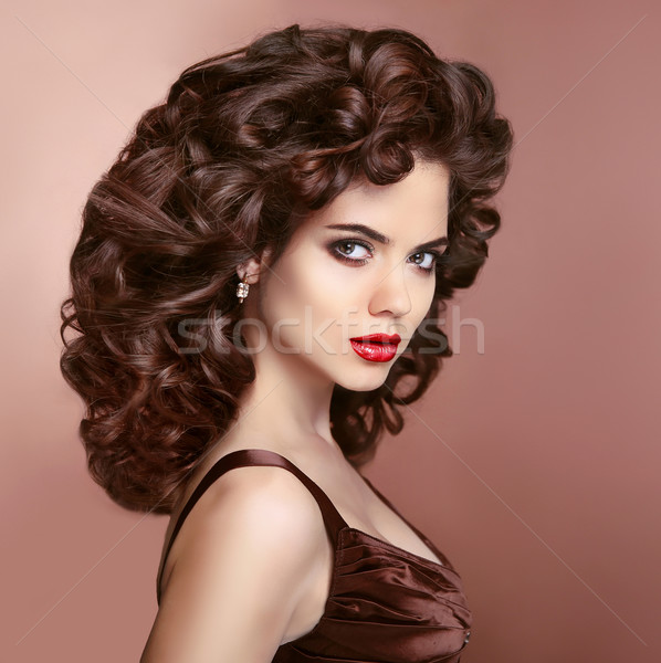 Hair. Makeup. Brunette woman with red lips and healthy curly hai Stock photo © Victoria_Andreas