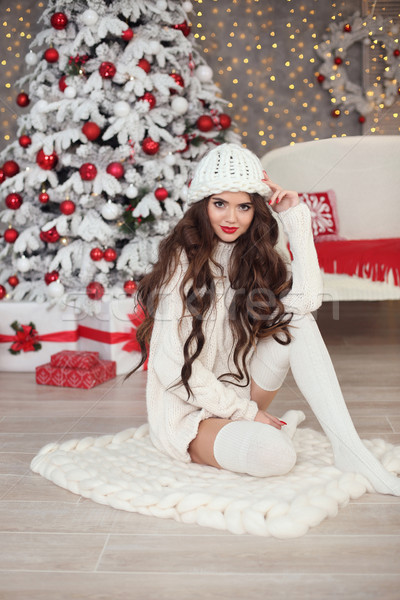 Christmas. Beautiful pretty woman in white knitted sweater, hand Stock photo © Victoria_Andreas