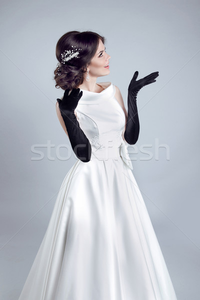 Beautiful bride woman with gloves in wedding dress showing on op Stock photo © Victoria_Andreas