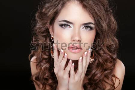 Beautiful model brunette with makeup, long hair. Manicured nails Stock photo © Victoria_Andreas