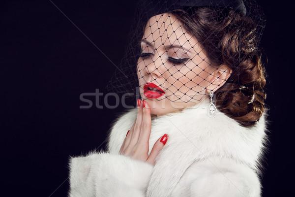 Retro woman. Fashion model girl portrait.  Isolated on black bac Stock photo © Victoria_Andreas