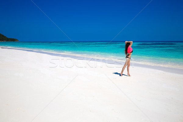 Enjoying life. Healthy woman walking on exotic sea. Fit brunette Stock photo © Victoria_Andreas
