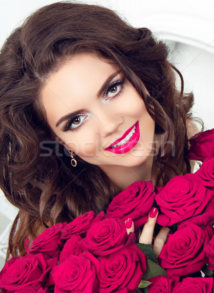 Beauty girl portrait. Happy smiling teen with pink roses bouquet Stock photo © Victoria_Andreas