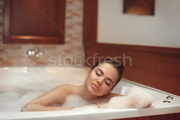 Skincare. Wellness. Beautiful Young woman relaxing in jacuzzi ba Stock photo © Victoria_Andreas