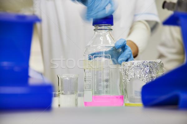 laboratory bottle solution Stock photo © vilevi