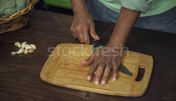Smashing Pressing Garlic Board Stock photo © vilevi