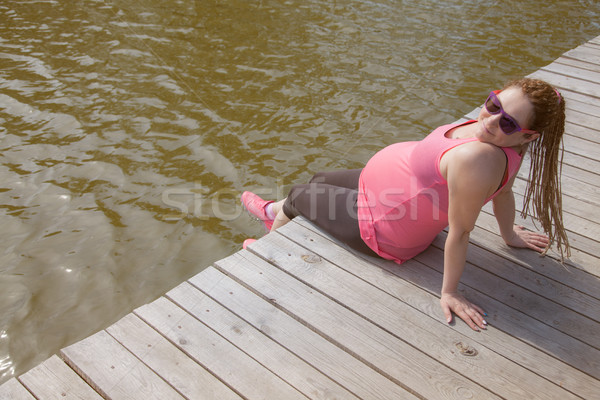 Pregnant Woman Quay Smiling Stock photo © vilevi