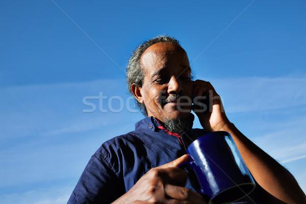 rasta man black portrait mug tea phone Stock photo © vilevi