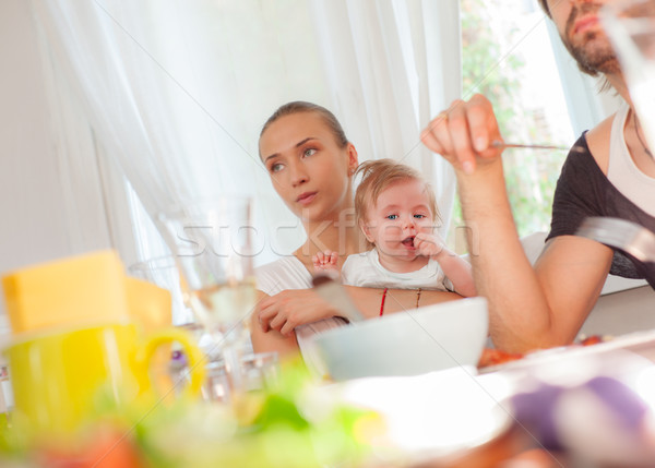 Baby eating family restaurant Stock photo © vilevi