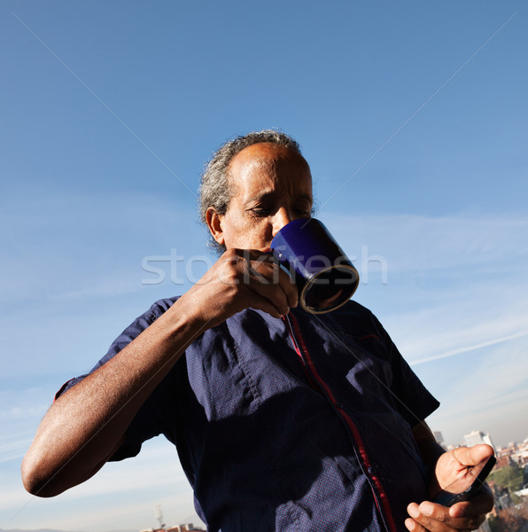 rasta black man drinking cofee tea phone Stock photo © vilevi