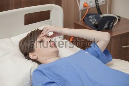 Ospedale femminile paziente mal di testa dolore giovani Foto d'archivio © vilevi